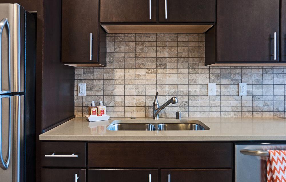 Kitchen sink with dark wood appliances
