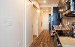 One Bedroom with sliding door to kitchen area
