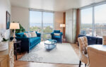 Two Bedroom living room with blue couches