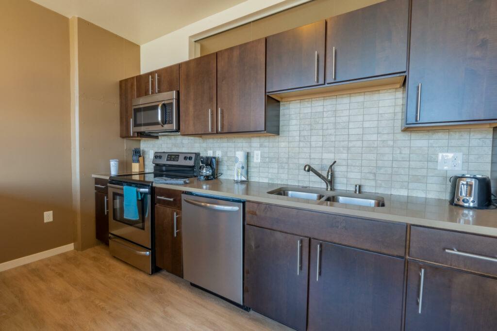kitchen-with-brown-tile-backsplash