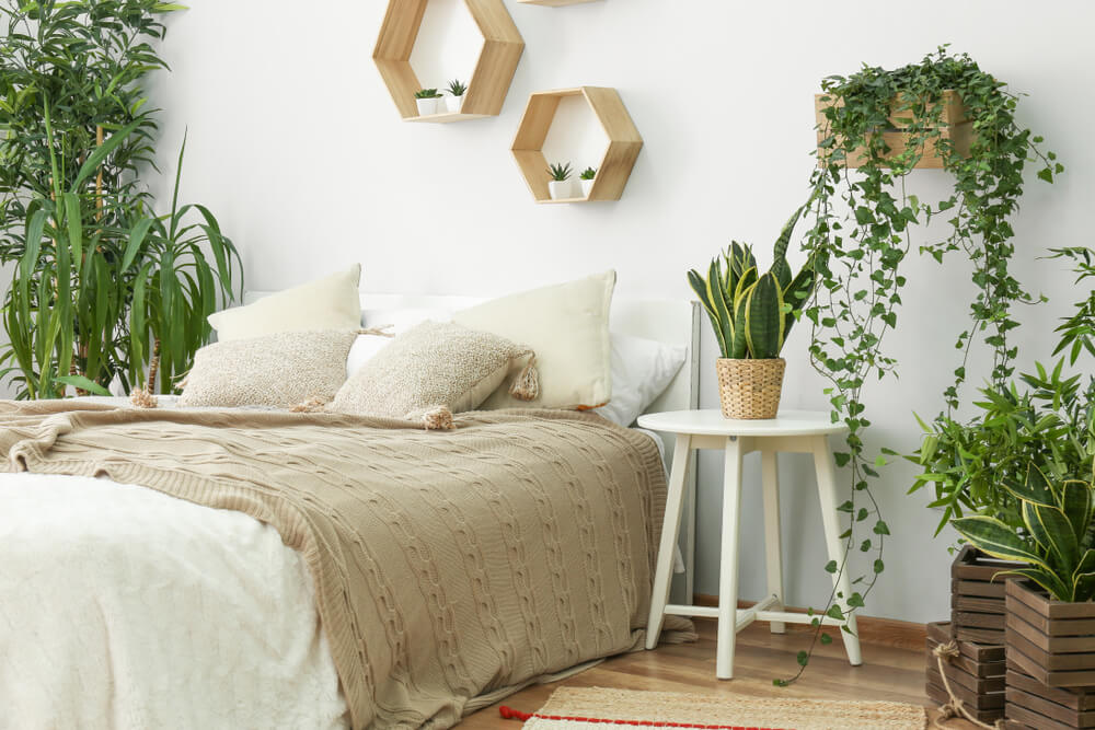 Bedroom with lots of green plants